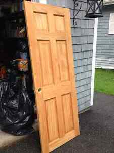 2 used solid pine indoor doors   $15. each or both for $25.