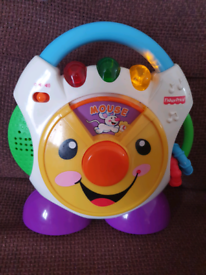 Fisher price baby toy with nursery rhymes