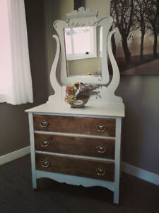 Antique dresser with mirror.