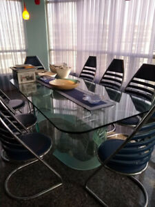 Custom built dining room set table with 8 chairs.