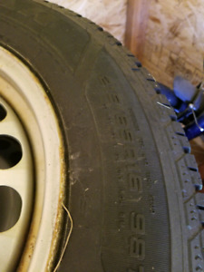 215 65 R16 Goodyear Ultra Grip Winter Tires and VW Tiguan Rims