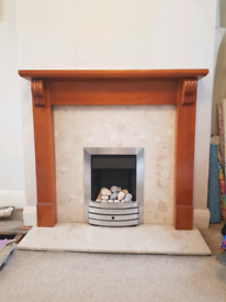Gas fire with marble hearth and wooden mantlepieve