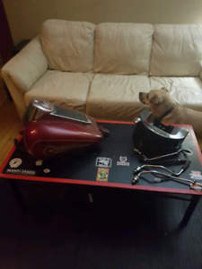 Harley tanks and assorted parts.