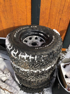 selling a Set of 4 BF goodrich KO2 tires and tires and rims