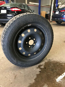 Winter tires on rims, used one winter