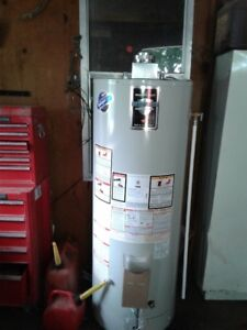 BRAND NEW 60 GALLON NATURAL GAS HWT, WITH FULL CHIMNEY KIT