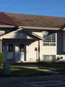 Townhouse with fenced yard with Immediate Availability