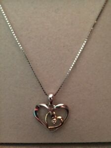 Striking silver and 14kt gold double heart necklace