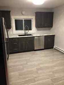 Renovated in Grand Bay! All new finishes, AVAILABLE NOW!