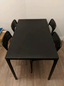 Black wooden dining table with 4 chairs - $50 for whole set