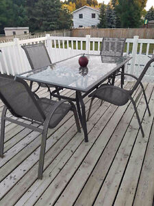 Patio set,  tempered glass top with 4 chairs, $130