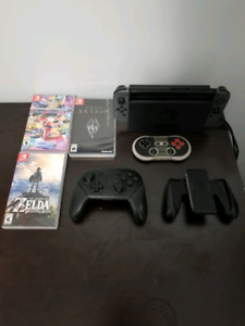 Nintendo Switch with 3 controllers and games