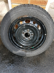 """Set of four 16"""" Winter tires with rims"""