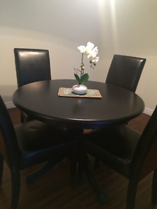 Round dining table with 4 chairs $475