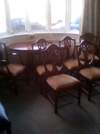 solid mahogany dining room table and chairs