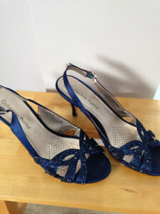 Ladies dress shoes worn for a wedding once. Beautiful blue