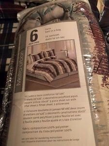BRAND NEW never opened 6 piece TWIN size bed in a bag!