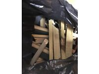 Bin bag full of wood offcuts suitable for kindling