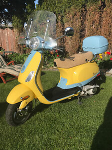 VESPA - not just a scooter, they're a lifestyle.  Think Italy!