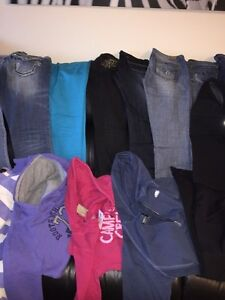 FULL garbage bag -Brand name jeans/tops, GUESS, ROOTS, LULULEMON London Ontario image 1