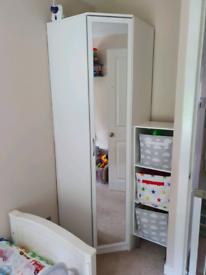 White corner wardrobe with mirrored door