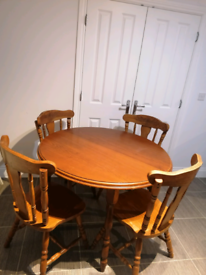 Round wooden table and 4 chairs