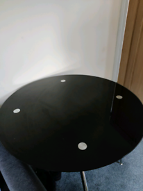 Glass round dining table, black and metal with 4 X cushion chairs