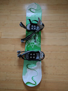 Kids snowboard and 3 pairs of boots