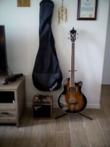 Ibanez acoustic bass, cable, gig bag and amp for sale.