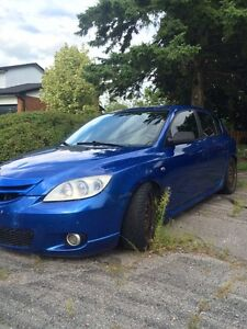 2004 Modified  Clean Mazda 3 Hatchback.  AS IS . FIRM!
