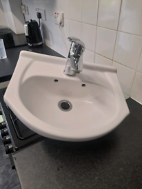 Basin with tap