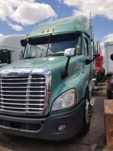 2013 Freightliner Cascadia with new engine auto trans