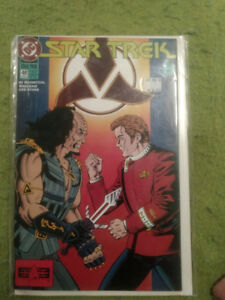Comics with plastic and cardboard backing. Pristine. Star Trek.