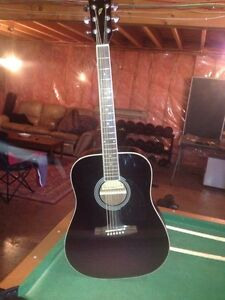 Black Ibanez acoustic guitar and case