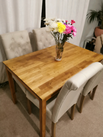 Solid oak wooden dining table with 4 Chesterfield chairs