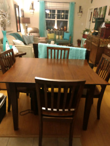 Dining table and four wooden chairs