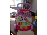 Vtech first steps walker and in the night garden carousel.