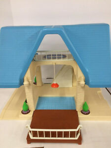 """Lovely modern  """"bungalow' doll house with  furniture."""