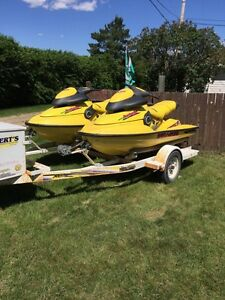 Two 1998 800 xp sea doos with trailor