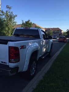 2011 GMC Sierra Z71 4x4 - white short box with lift kit