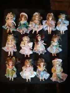 Thirteen Four inch tall porcelain dolls.  All very unique