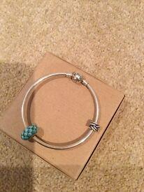 Genuine Pandorra Silver Bracelet and 2 Charms
