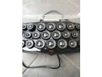Babyliss heated rollers in case with all clips Ref 3034U