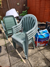 Four plastic chairs