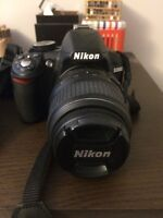 Nikon D3100 DSLR body and 2 Nikon lenses