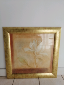Golden frame with flower picture