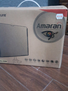 Amaran photography light and two stands.
