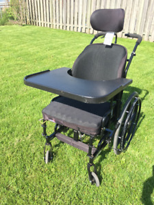 Concept 45 tilting wheelchair with tray and foot plates