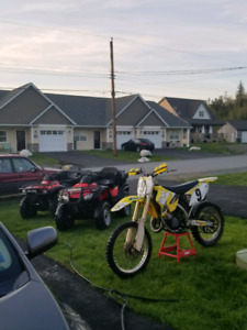 2003 suzuki rm 125 ( trade for race quad)