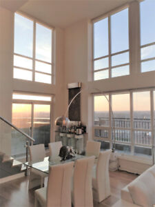 UNOBSTRUCTED MILLION DOLLAR VIEWS FROM THIS TWO-STORY PENTHOUSE!